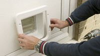 Installing the SureFlap Microchip Pet Door in a door